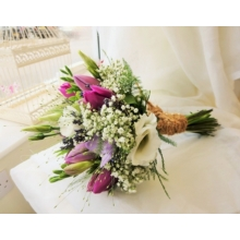 Tulip, lisianthus, freesia and gypsophila with asparagus fern and panicum grass enhanced with rustic binding