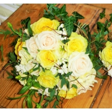 Tara and Vandela rose, bouvardia and lisianthus with eucalyptus and ivy trails enhanced with diamanté groupings.