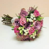 Amnesia rose, bouvardia and lisianthus with asparagus fern.