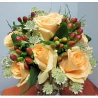 Peach Avalanche rose, hypericum berries and astrantia  with asparagus fern.