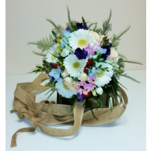 Germini, bouvardia, spray rose, lisianthus, freesia, delphinium, alstroemeria and veronica with asparagus fern and enhanced with hessian ribbons.