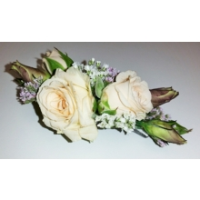 Spray rose, lisianthus, gypsophila and limonium attached to a small hair comb.
