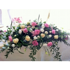 Aqua and Sweet Avalanche rose, hydrangea, lisianthus and lysimachia with coordinating foliage.