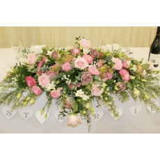 Amnesia and Avalanche Pink roses, bouvardia, lisianthus, freesia and September flower with mixed foliage.