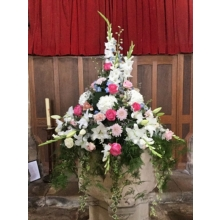 Font decorated with Sweet Avalanche, Avalanche Pink and All 4 Love roses, delphinium, lily, gladioli, chrysanthemum blooms, lisianthus and limonium with coordinating foliage.