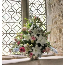 Church window sill vase filled with Sweet Avalanche, Avalanche Pink and All 4 Love roses, delphinium, lily, lisianthus and veronica with coordinating foliage.