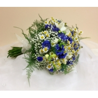 Cornflower, freesia, tanacetum and gypsophila with asparagus fern bound with ivory voile ribbon.